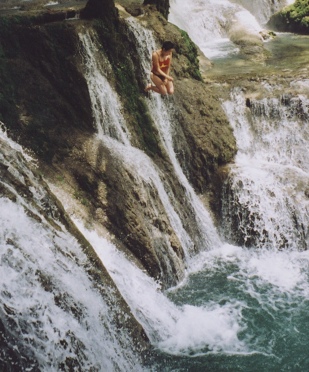 Jumping into a forest waterfall in Vietnam during a round-the-world sabbatical in 2001–2002