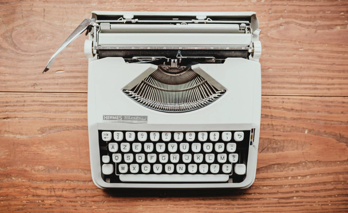 White typewriter via Unsplash
