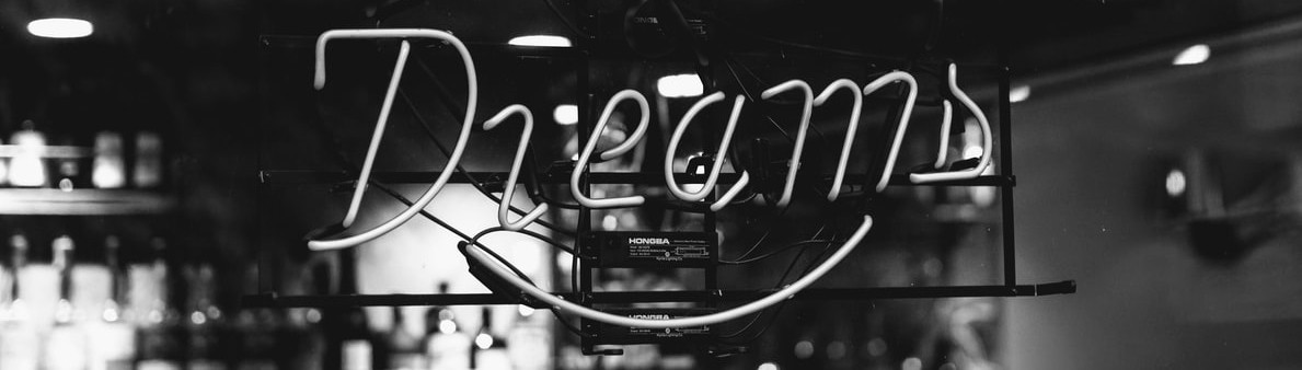 """An image of a neon sign with the word""""Dream."""""""
