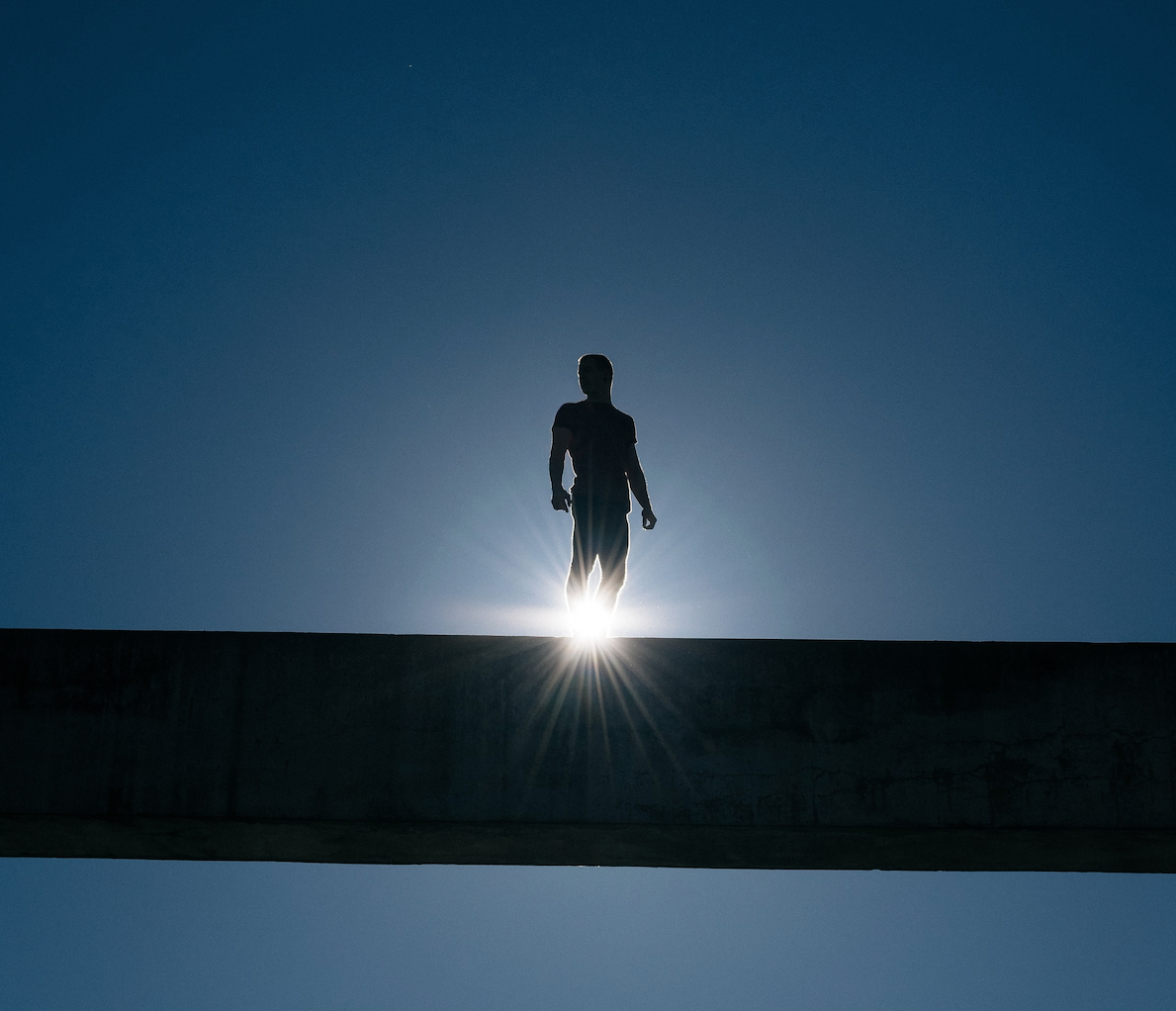 man standing on beam