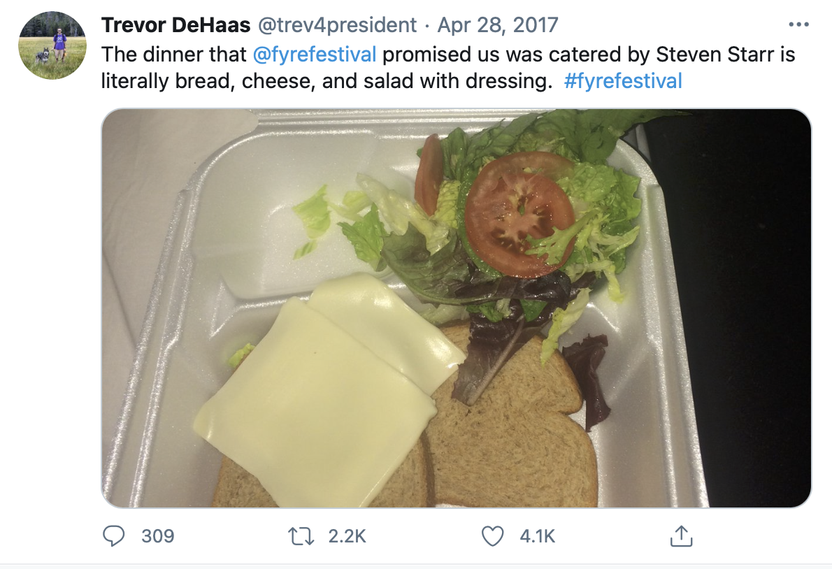 An image of the food that was served to festival-goers. A polystyrene tray filled with cheese, salad and bread