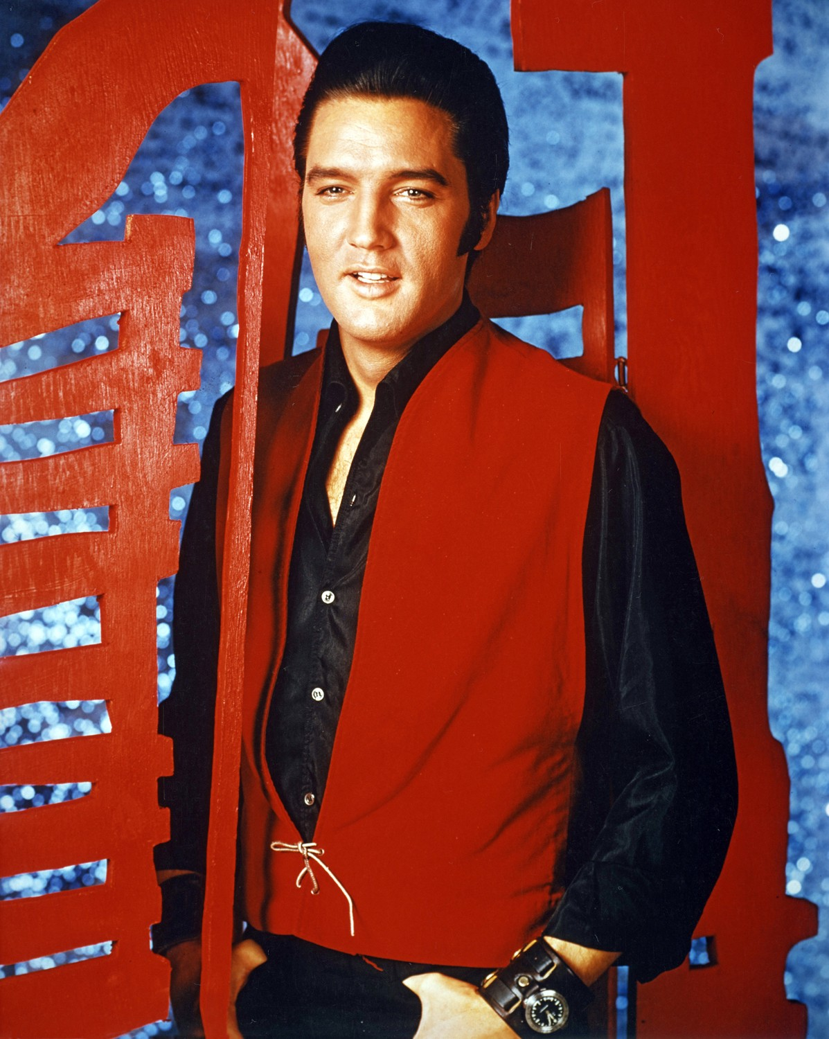 Red and black are a provocative combination in this promotional June 1968 photo shoot for the Elvis NBC special.