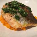 Seabass with carrot-top pesto on beet greens and carrot purée.