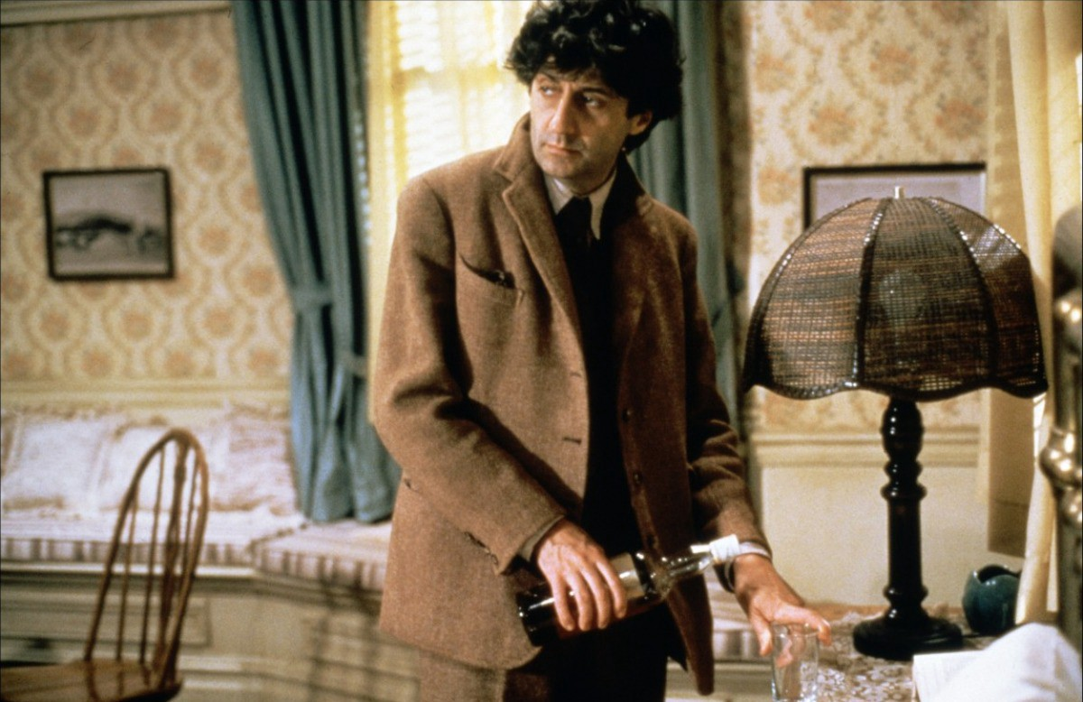Tom Conti dressed head to toe in tweed, pouring himself a whisky, as poet Gowan McGland in Reuben Reuben.