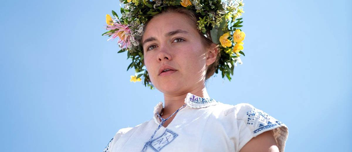 Florence Pugh in a white pagan outfit with a flower crown