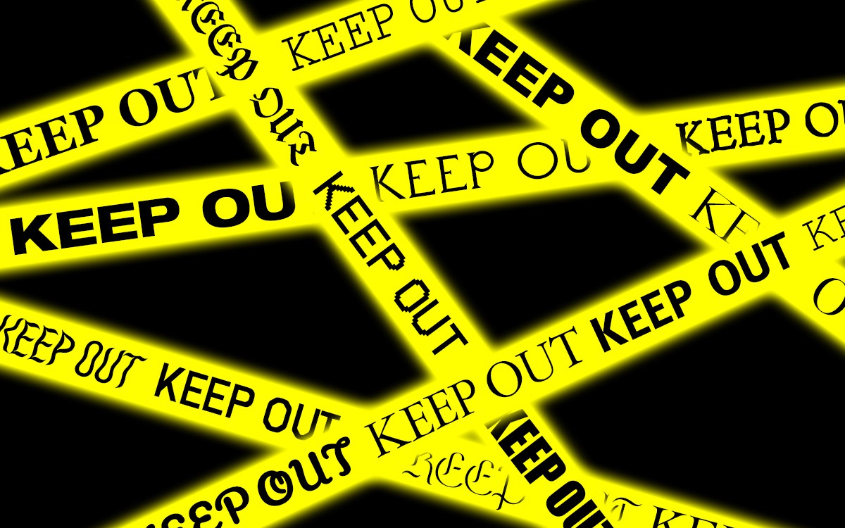 """Criss-crossed strips of yellow police tape with the words """"keep out"""" repeated in different font families."""