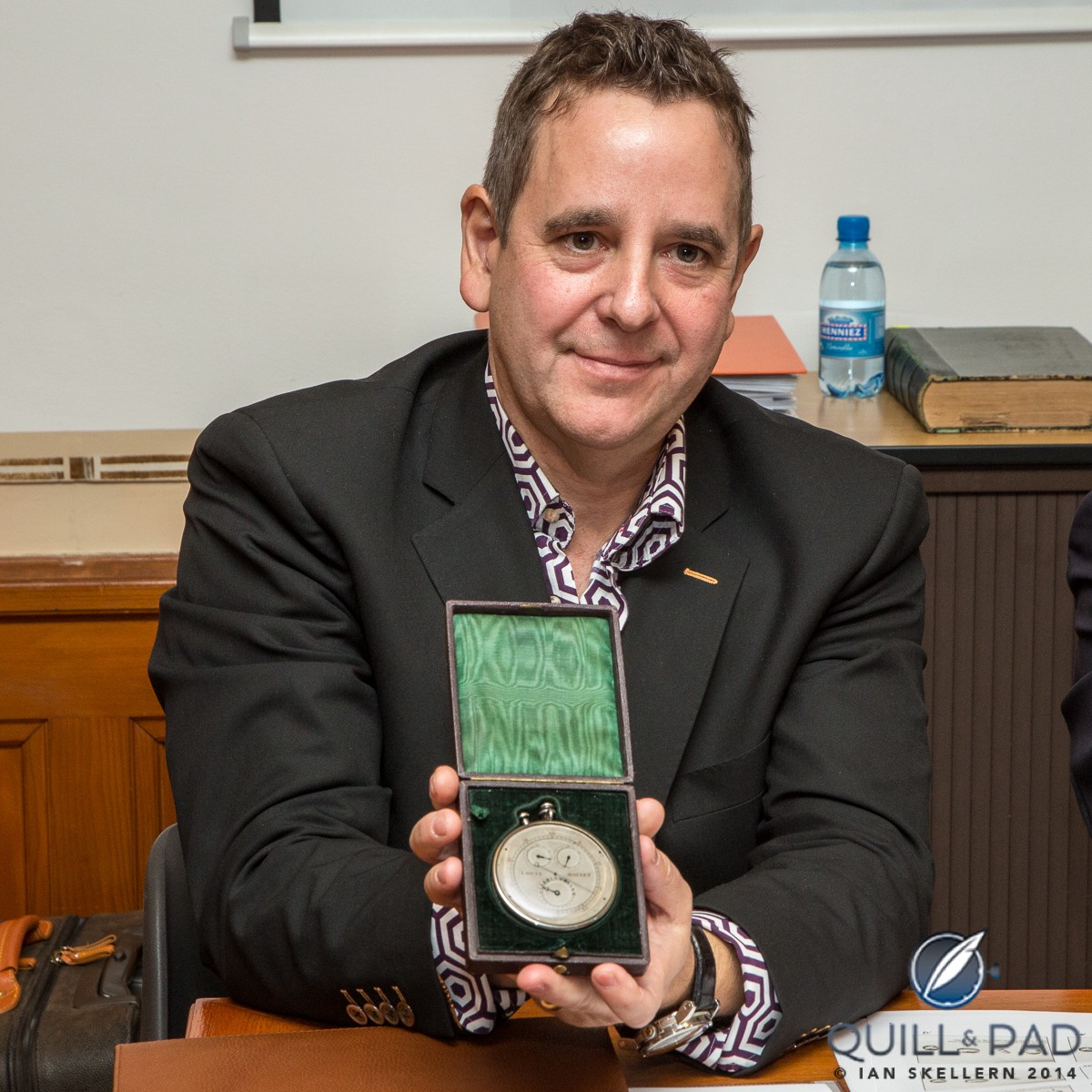 Jean-Marie Schaller, CEO and creative director of the modern Louis Moinet band, proudly holding the Compteur de Tierces