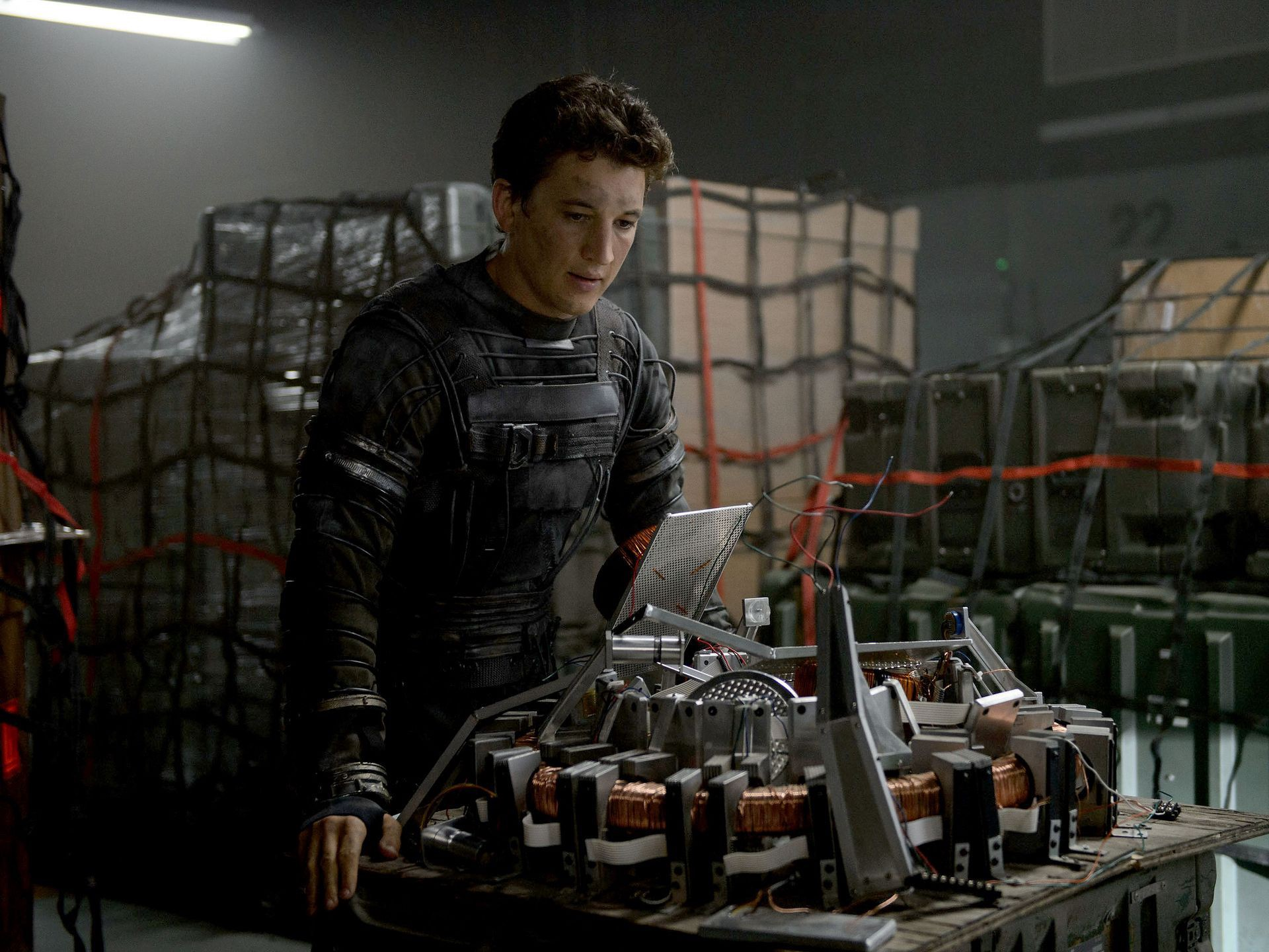 Miles Teller staring intensely as Reed Richards in Fantastic Four (2015)