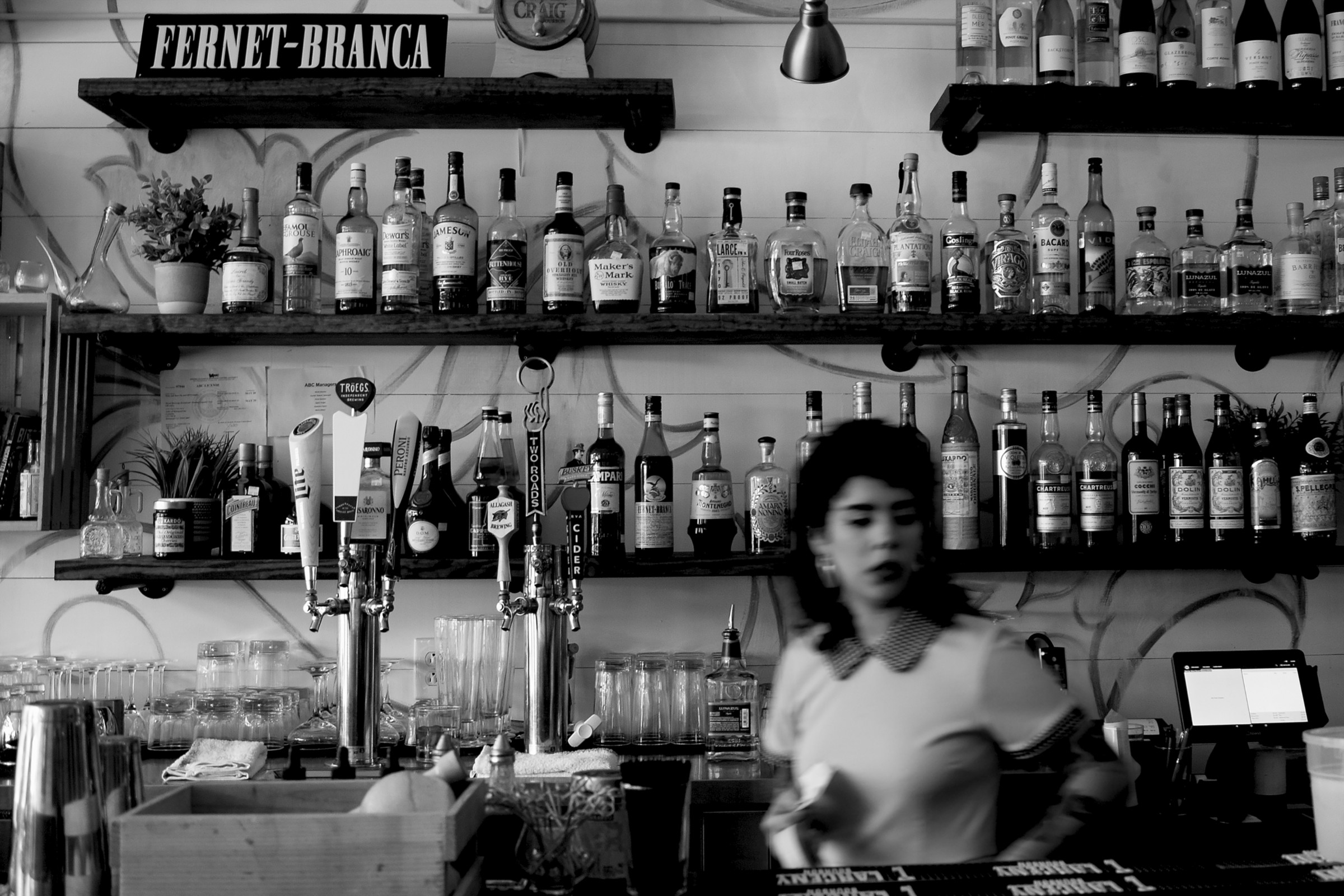 Cafe bar tender in black and white