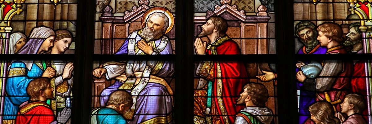 stained glass window showing Catholic confession