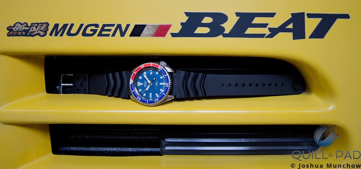 Seiko 7002 Diver nestled in an air vent of the author's Honda Mugen Beat