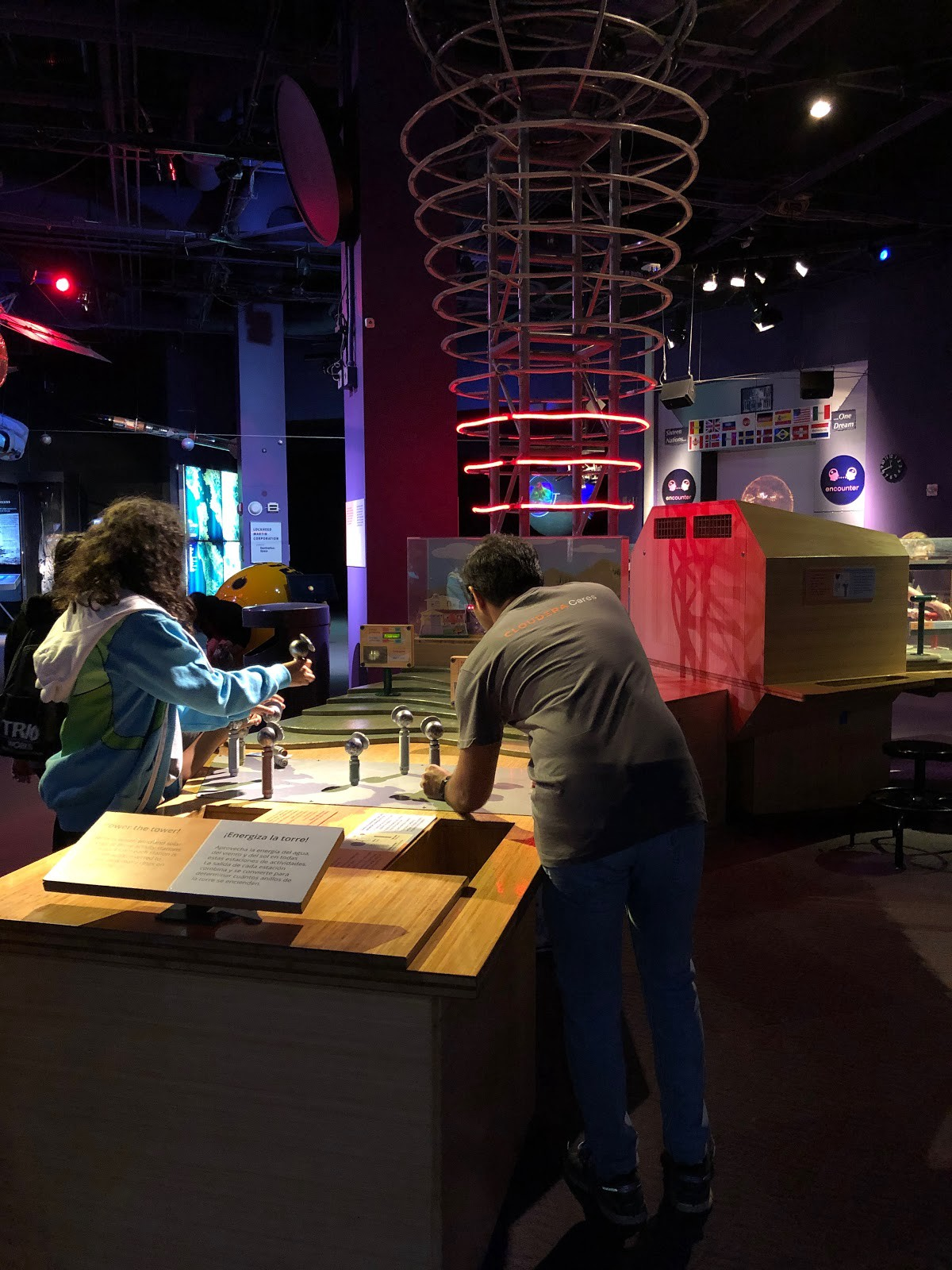 two people playing with science exhibit