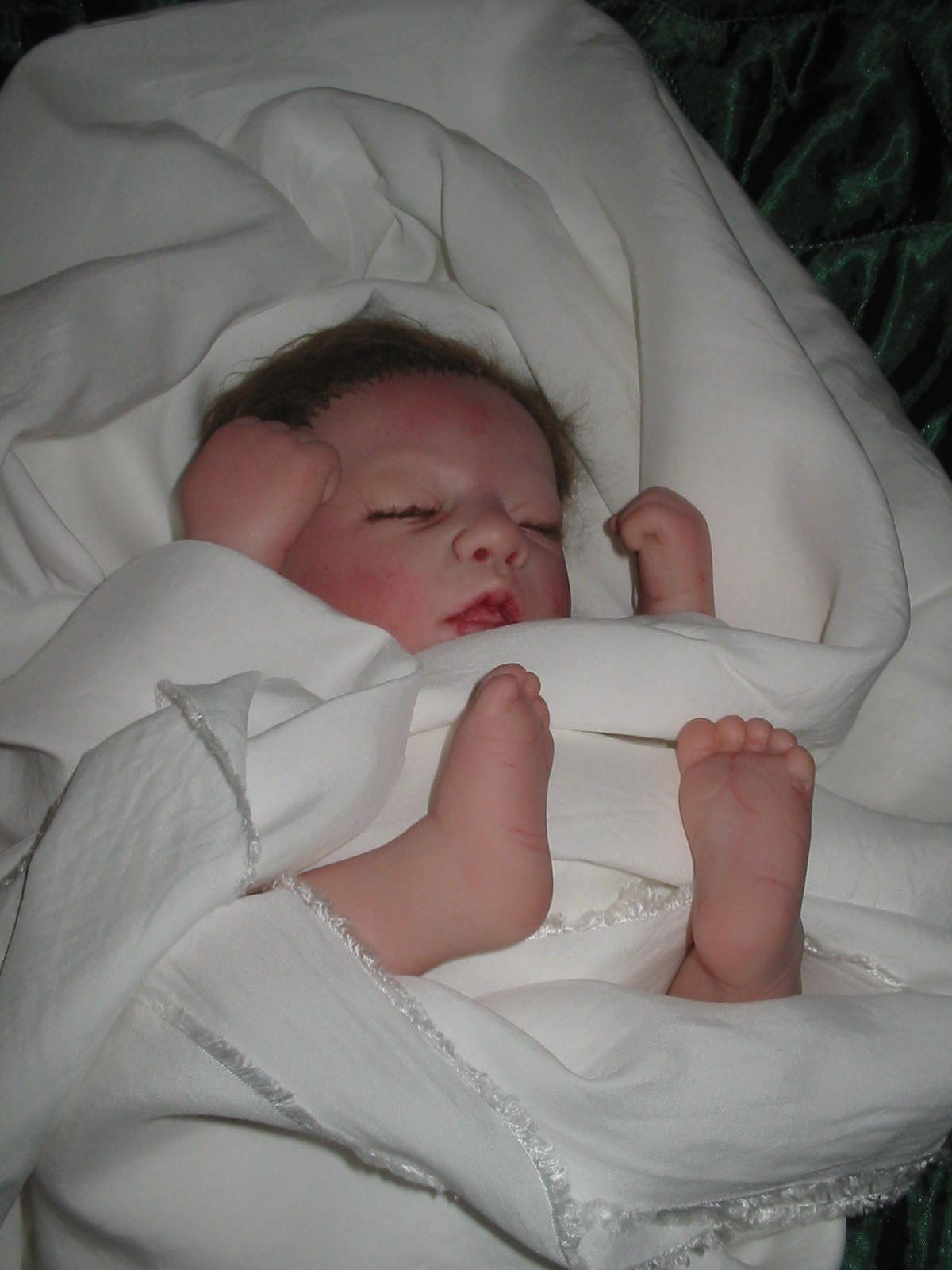 Hyperrealistic baby that is actually a doll.
