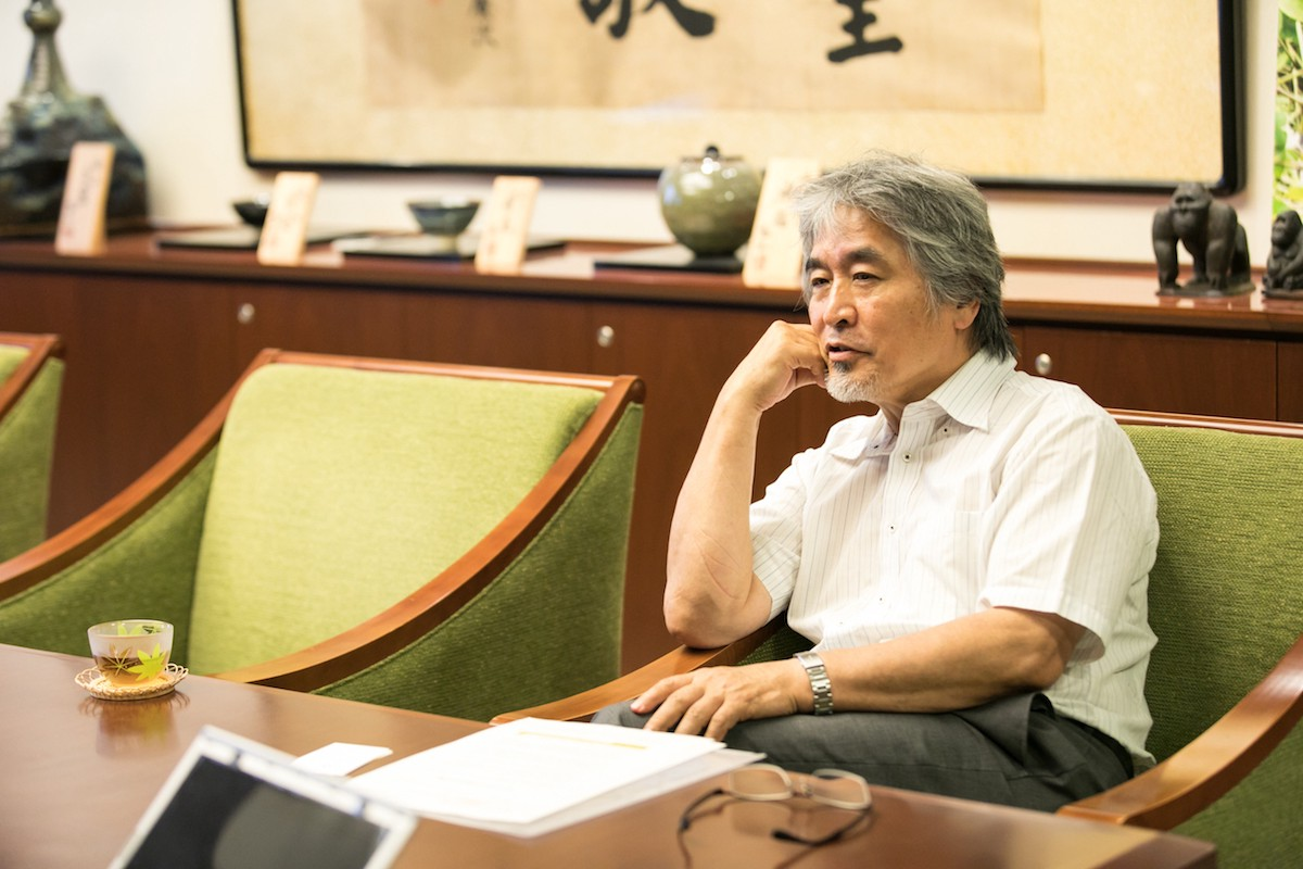 Professor Yamagiwa leaning against his office chair
