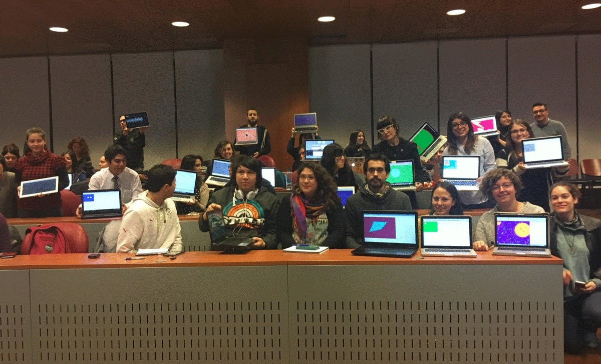 Large group of smiling artists display their laptops with first colorful sketches made with p5.js