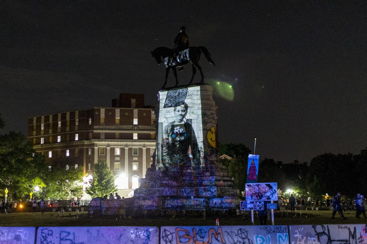 Robert E. Lee monument in Richmond, Virginia illuminated with an image of activist and abolitionist Harriet Tubman, June 2020