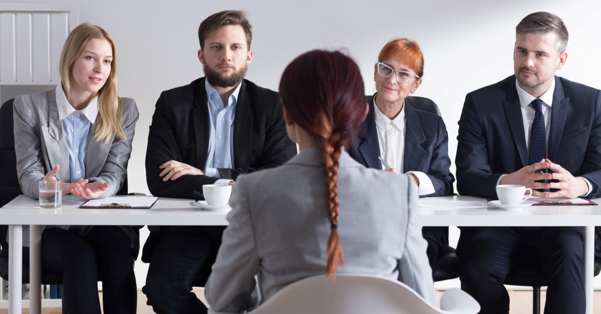 A group of recruiters in the process of interviewing an applicant.