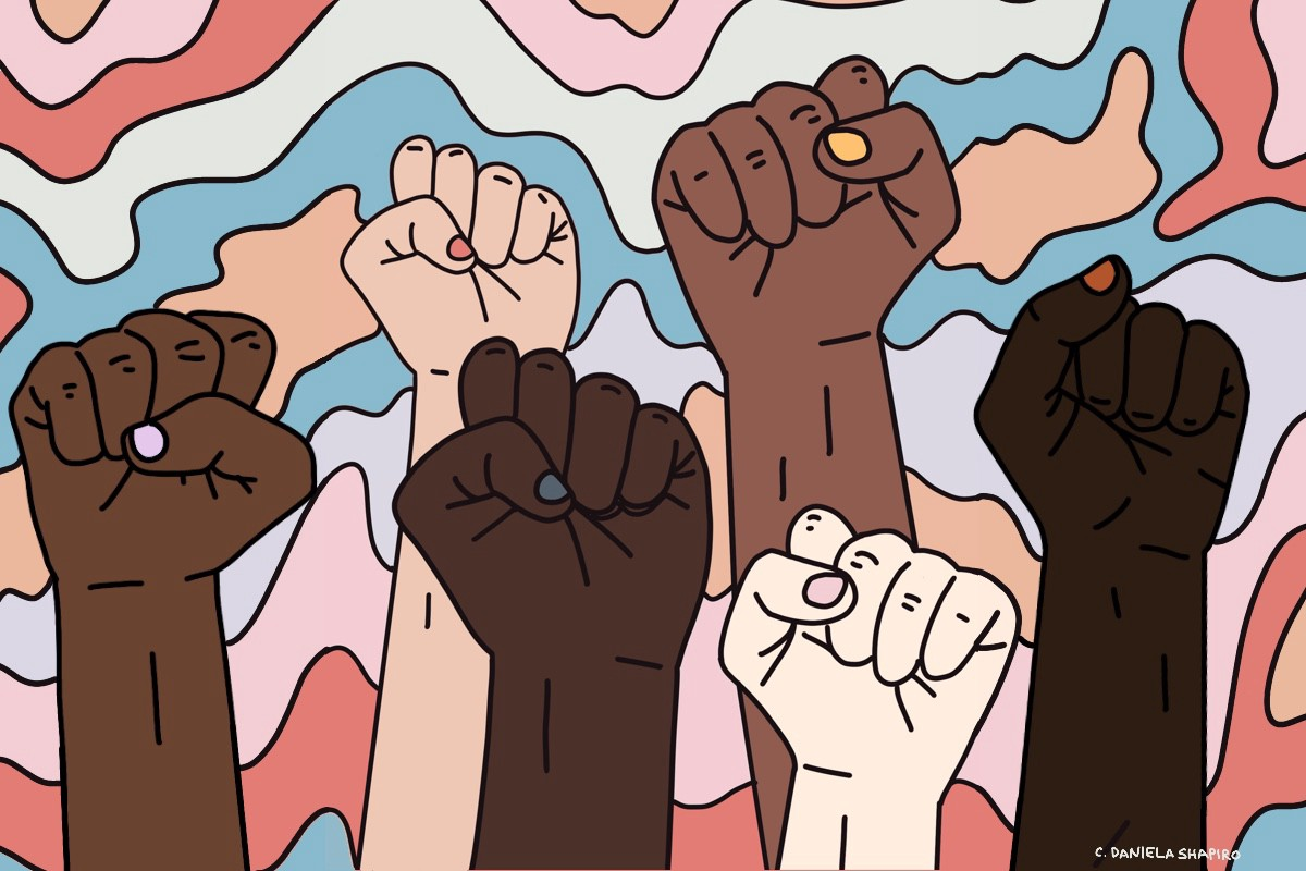 Fists held up representing multiple skin complexions