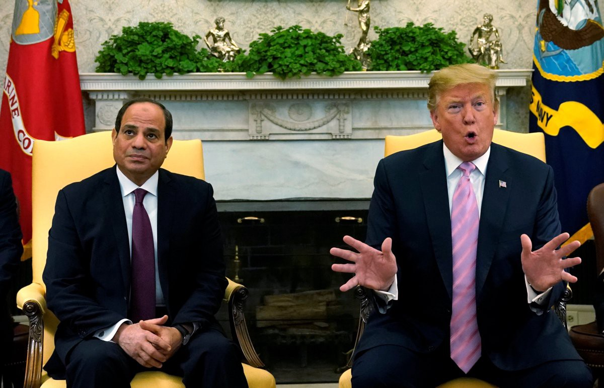 Egyptian President al-Sisi on the right looking up at the ceiling, and Donald Trump, the US president, gesturing on the right