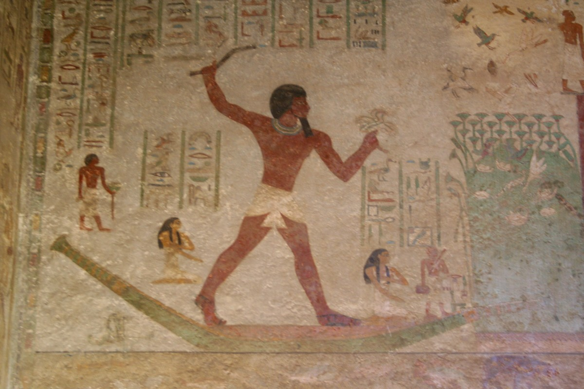 A stone wall with a painting of an Egyptian man