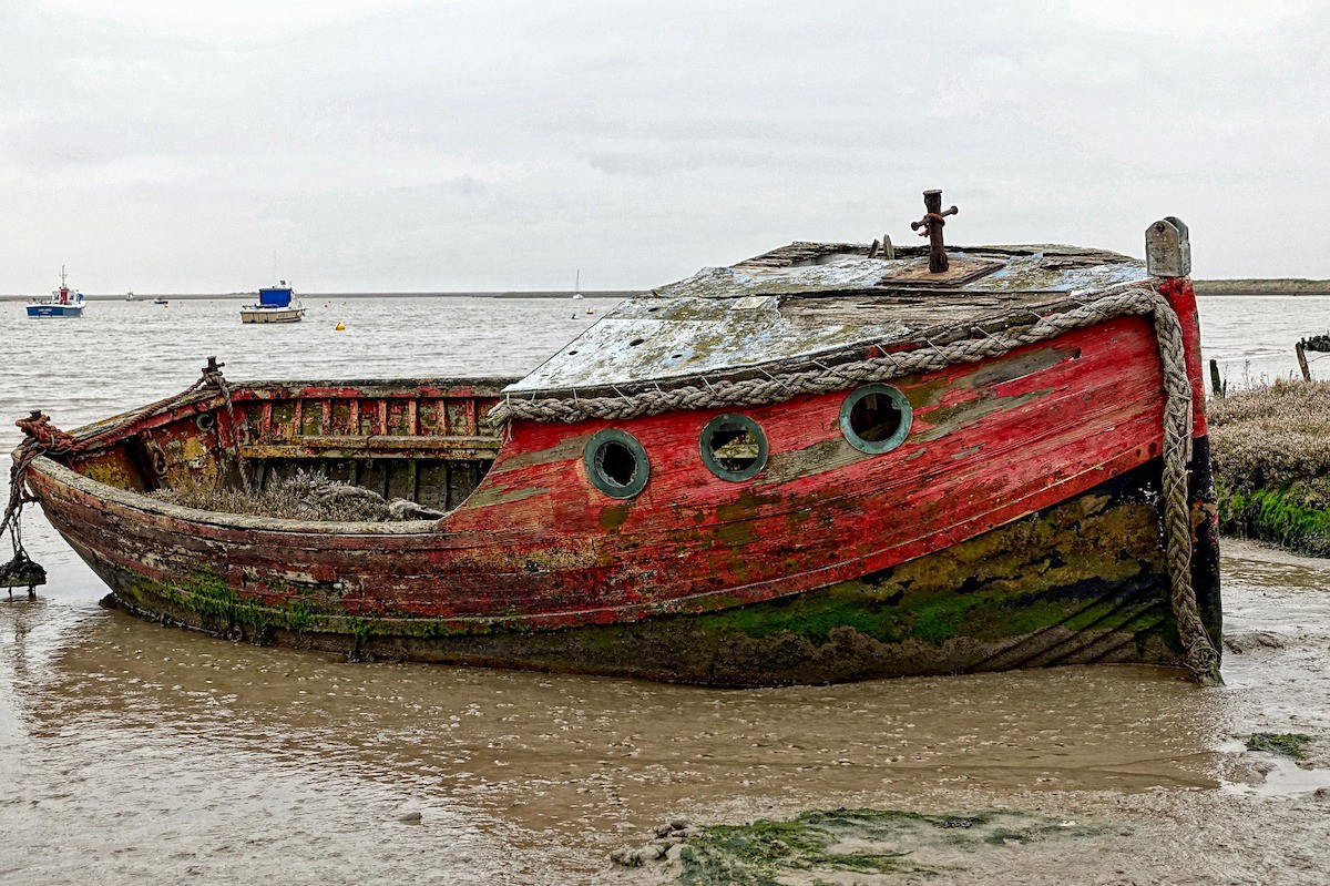 A small wooden boat resting at shore.