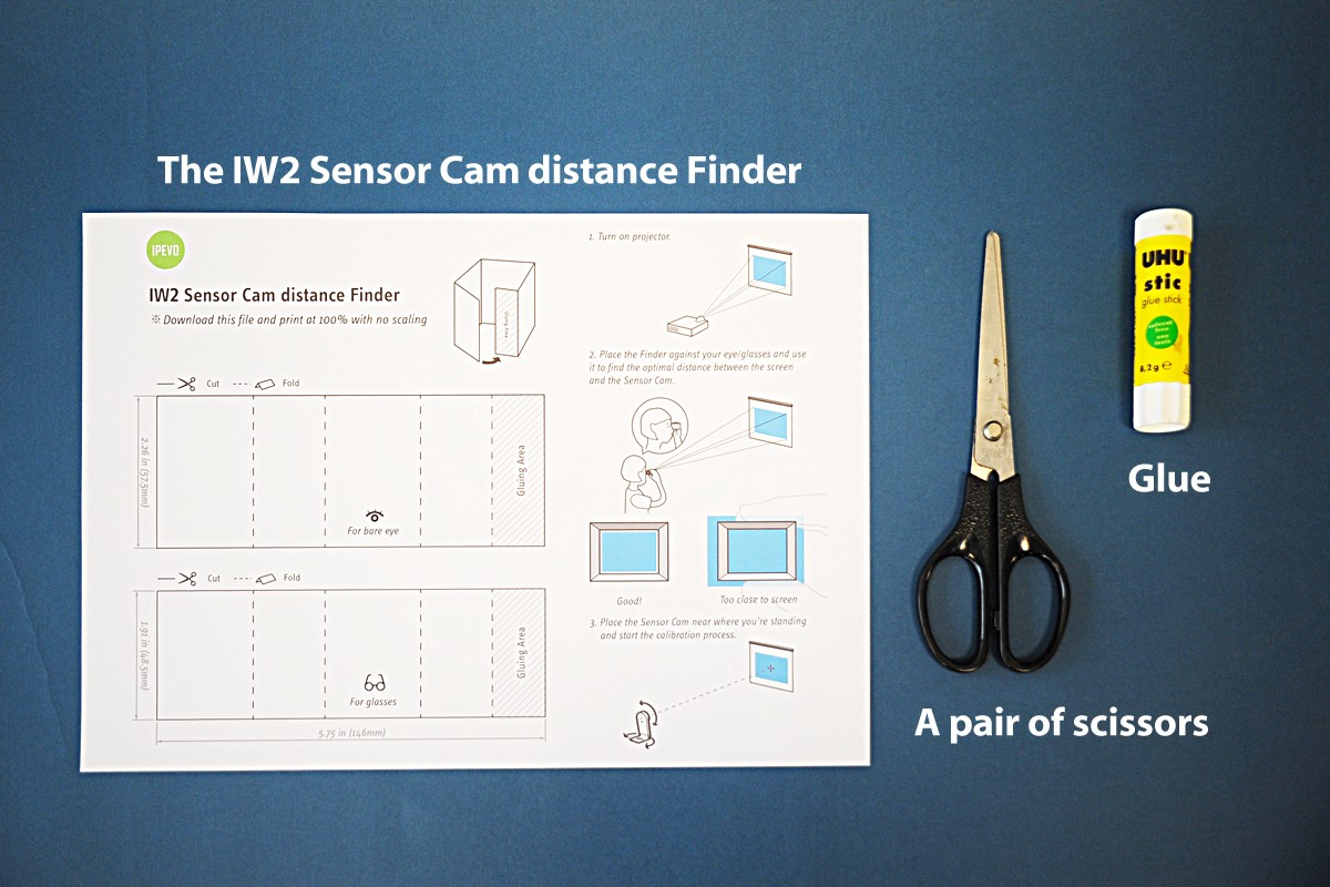 What you will need: The IW2 Sensor Cam distance Finder, A pair of scissors and Glue
