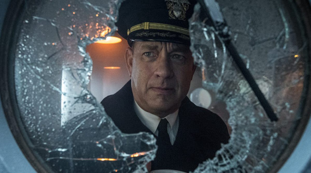 Commander Ernest Krause (Tom Hanks) looking through shattered porthole