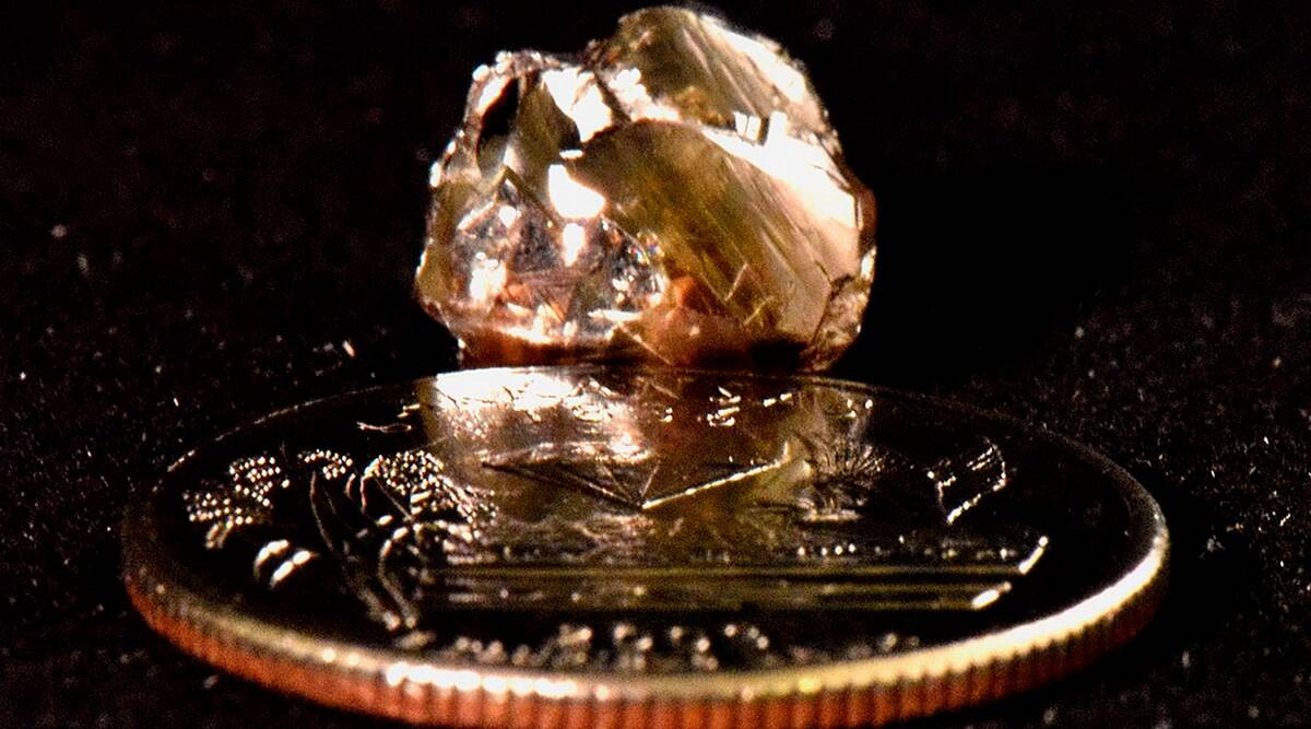 9.07 carat diamond on coin for scale