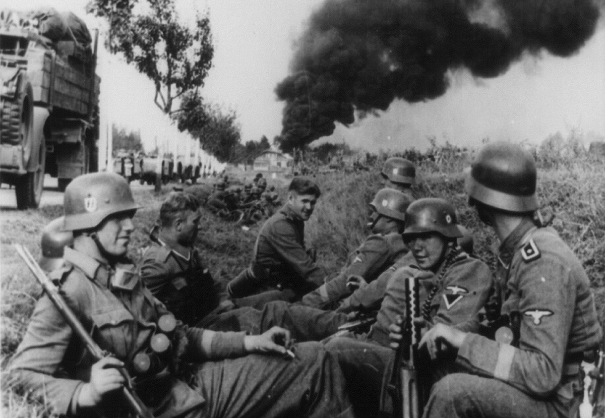 German-SS soldiers resting in a ditch alongside a road during the invasion of Poland in 1939