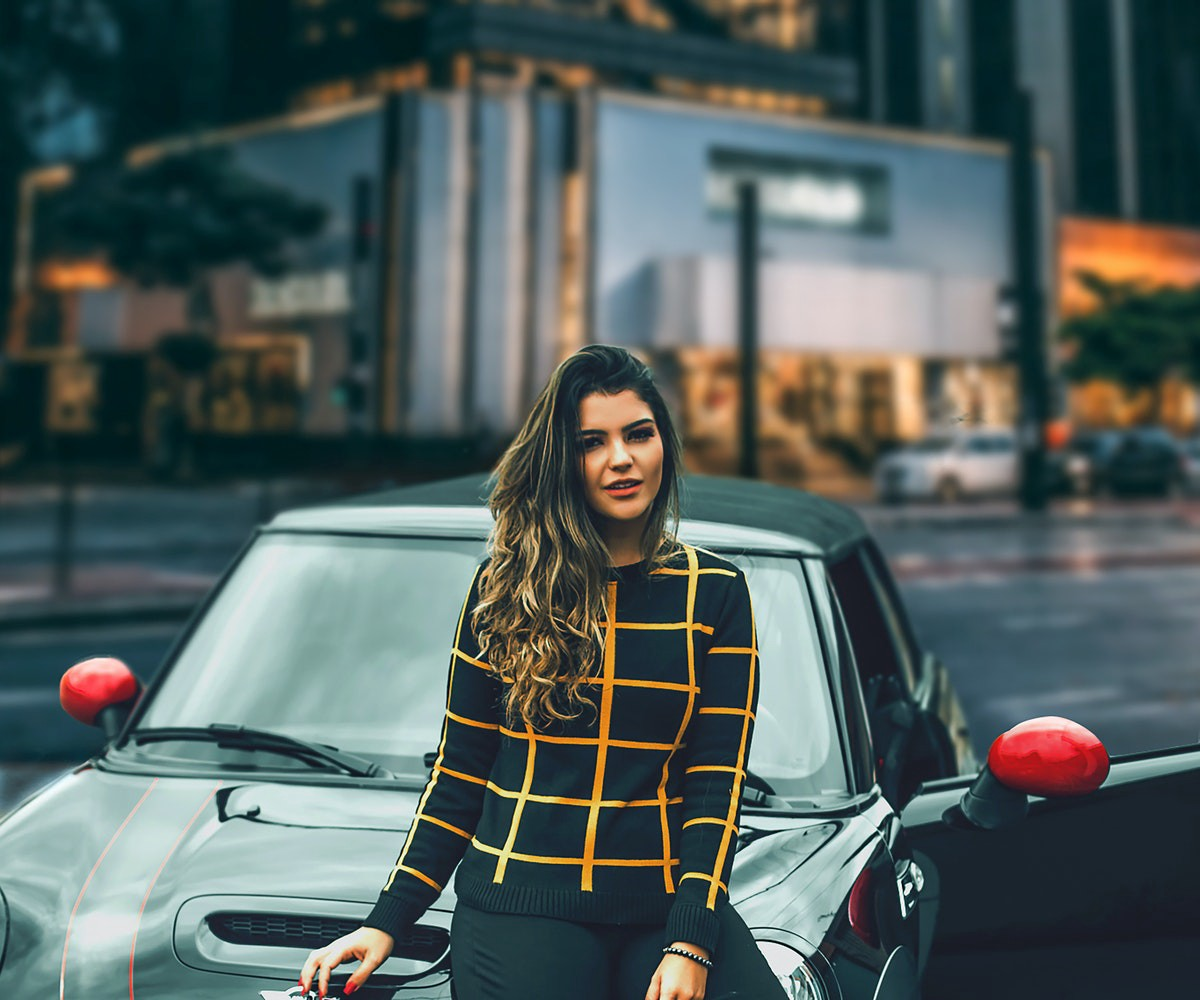 Photo of woman leaning on a car