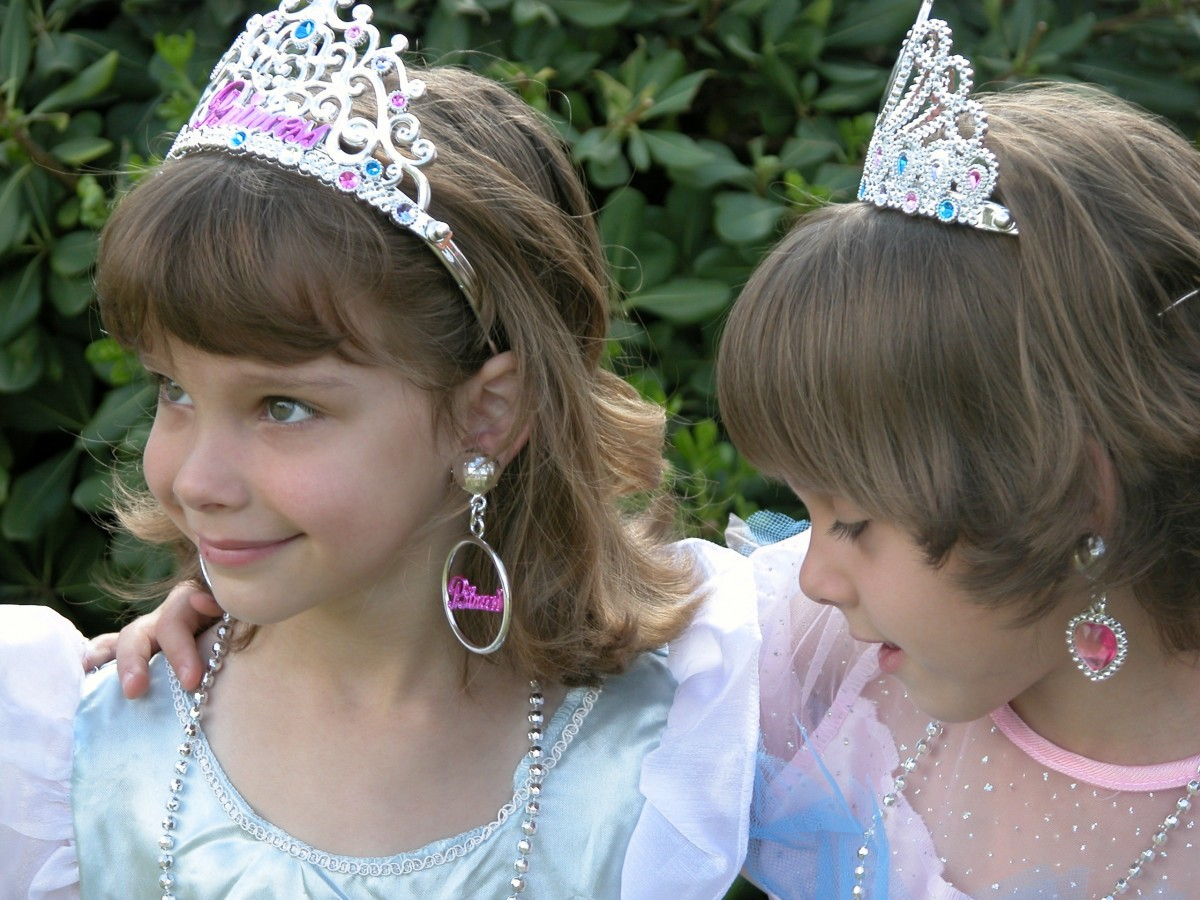 Two little girls dressed as princesses and looking utterly adorable