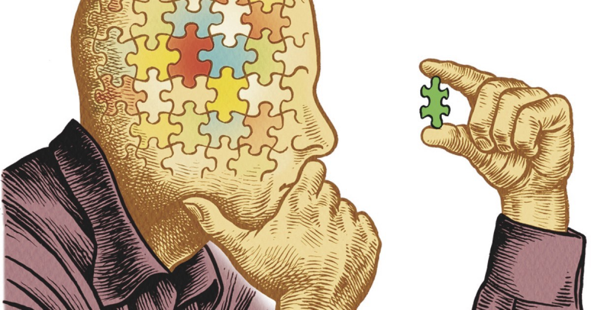 A man is thinking about how to fit a puzzle piece into his head.