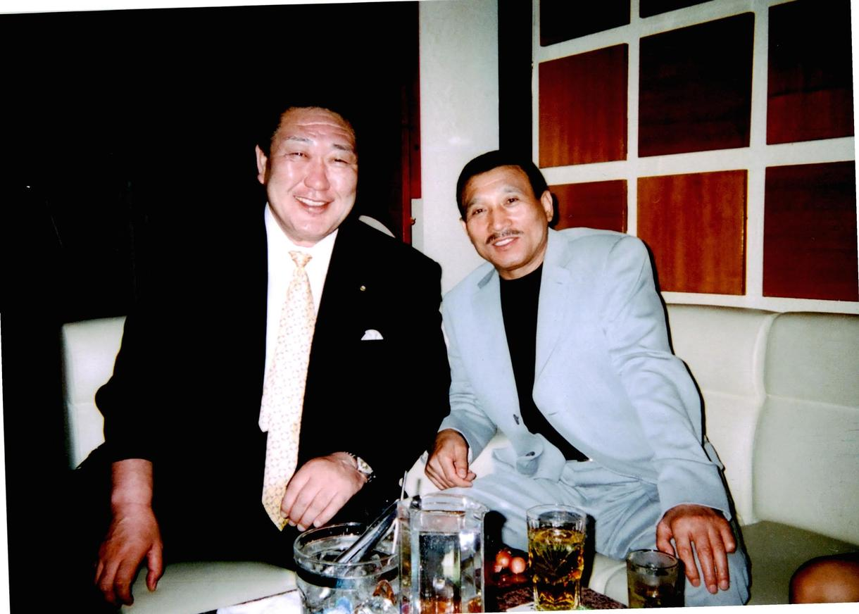 Vice chairman of the Japanese Olympic committee sitting next to Shinobu Tsukasa, the head of Japan's largest Yakuza syndicate