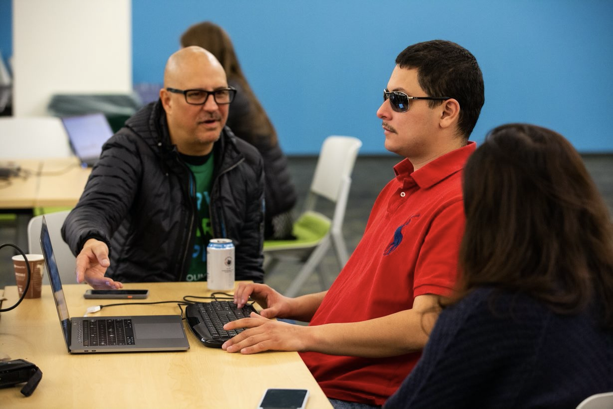 VMware accessibility engineer Chris Lane (Left) with Nicholas Alvarez and Nhi Nguyen (middle and right) @ A11y hackathon