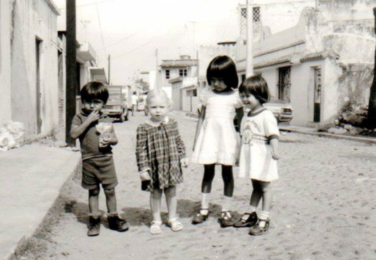 Photo of Linda as a small child in Veracruz, Mexico. Sticking out like a sore thumb.