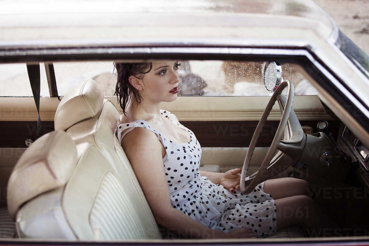 Woman in driving seat of car