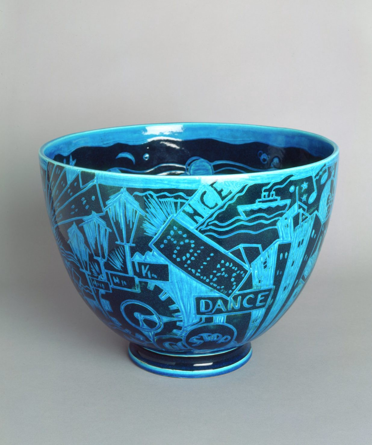 Black and blue ceramic bowl decorated with words and images related to jazz music in New York City.