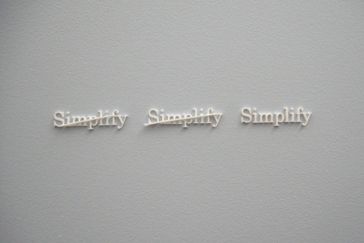 Apple - simplify-apple-sign-Quote