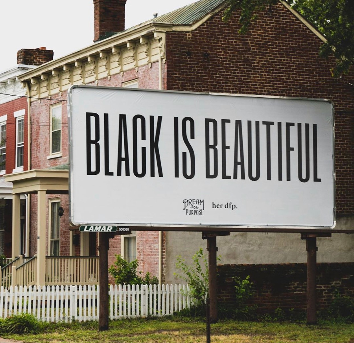 Ricky and Whitney Parker's Black Is Beautiful billboard in Richmond, Virginia.