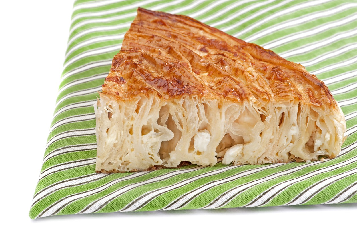 Home made cheese pie on white background