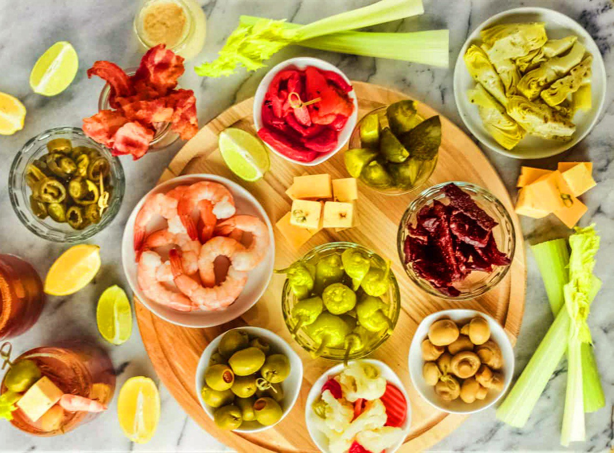 Make your own Bloody Mary bar spread: a dozen or so small bowls, each filled with a different type of garnish or condiment.