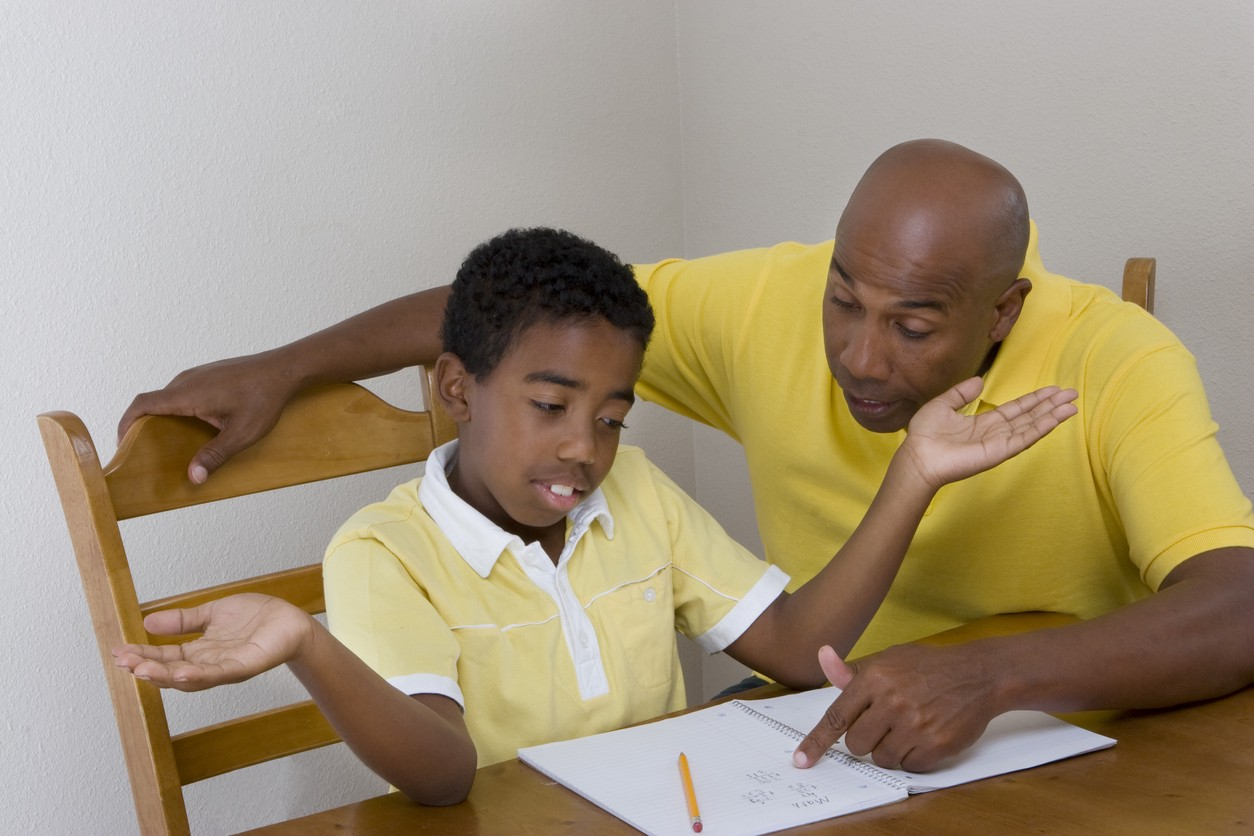 Parent trying to help his son with homework