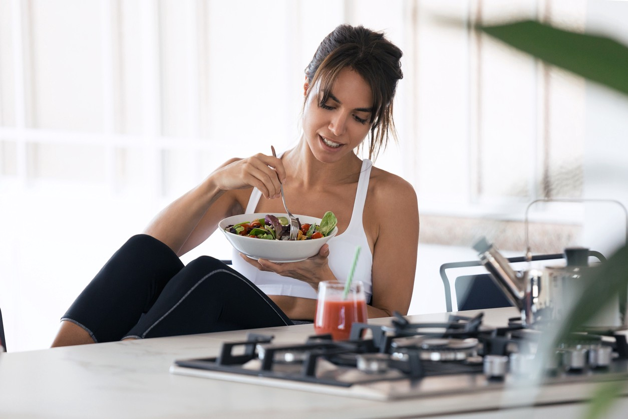 iStock image. Woman eating health meal.