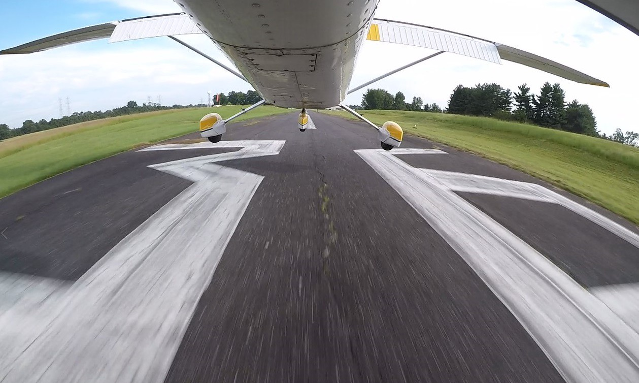 The undercarriage of a plan mid-landing.