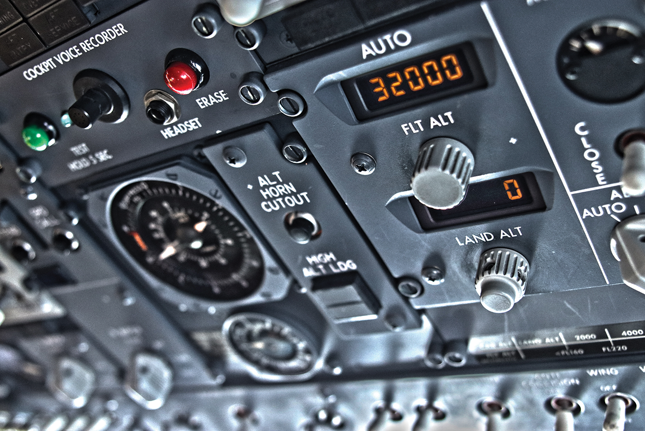 Photo of a portion of a cockpit with a lot of buttons.