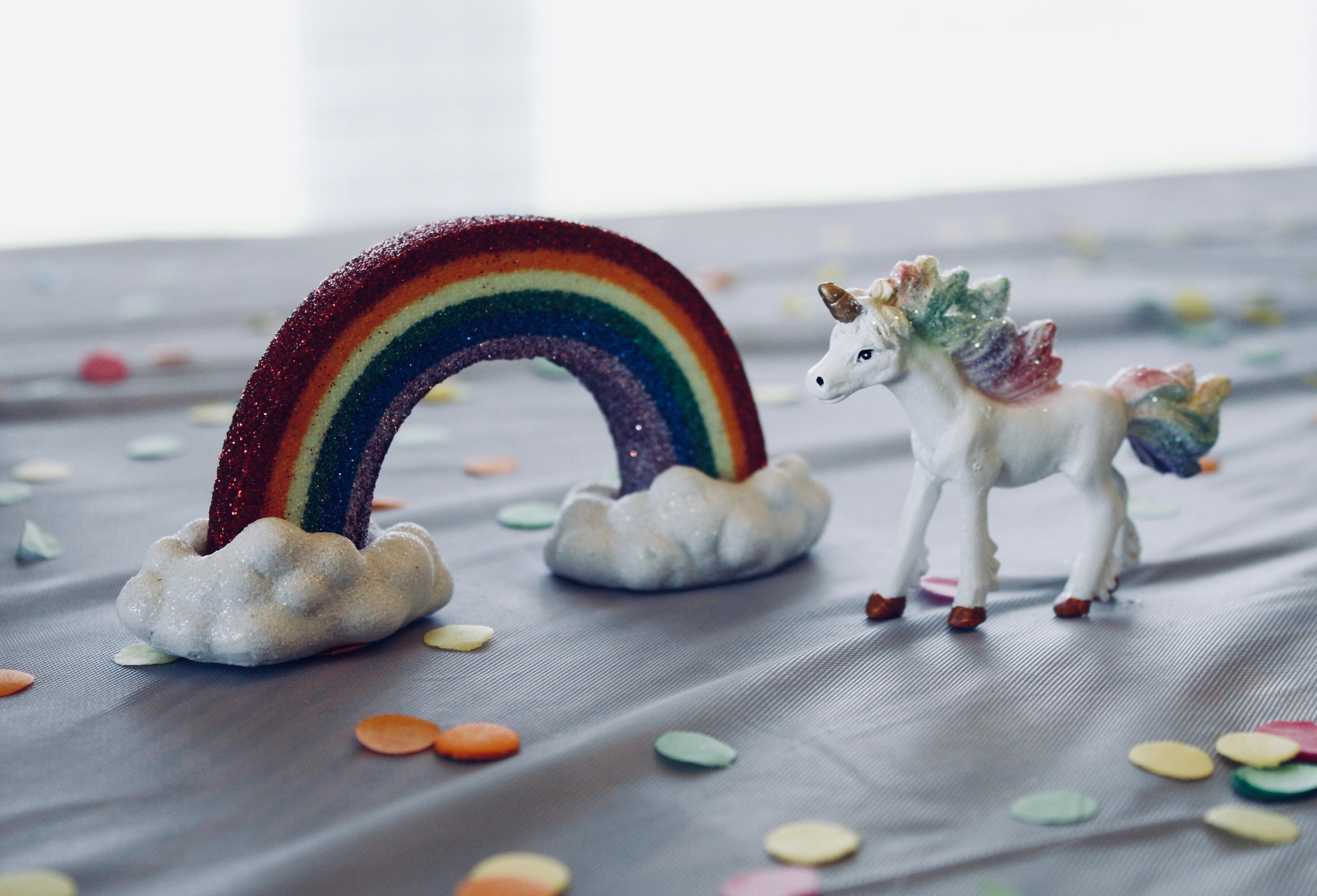 rainbow figurine and unicorn figurine
