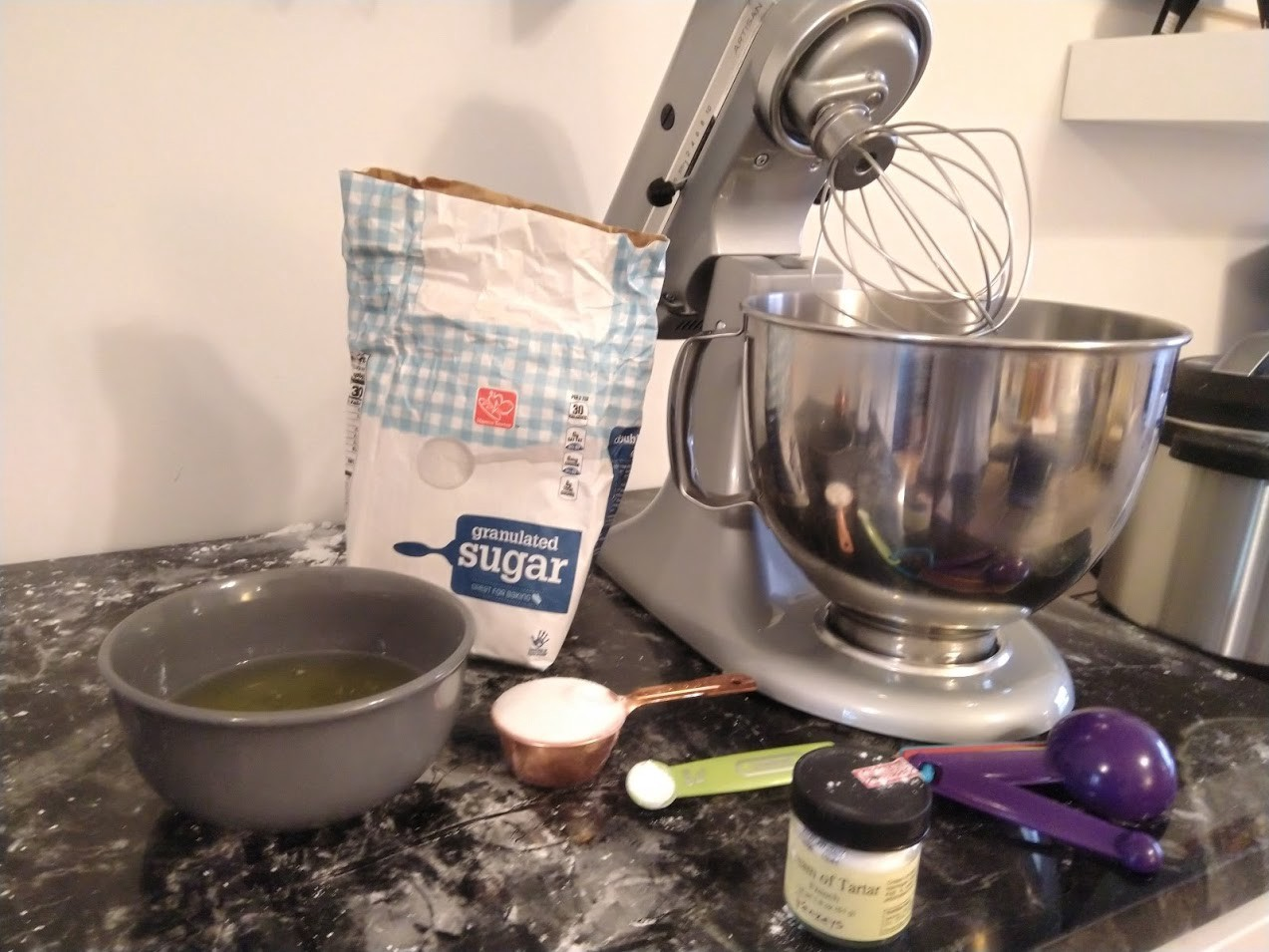 Ingredients for the meringue: egg whites, granulated sugar, cream of tartar and an electric stand mixer