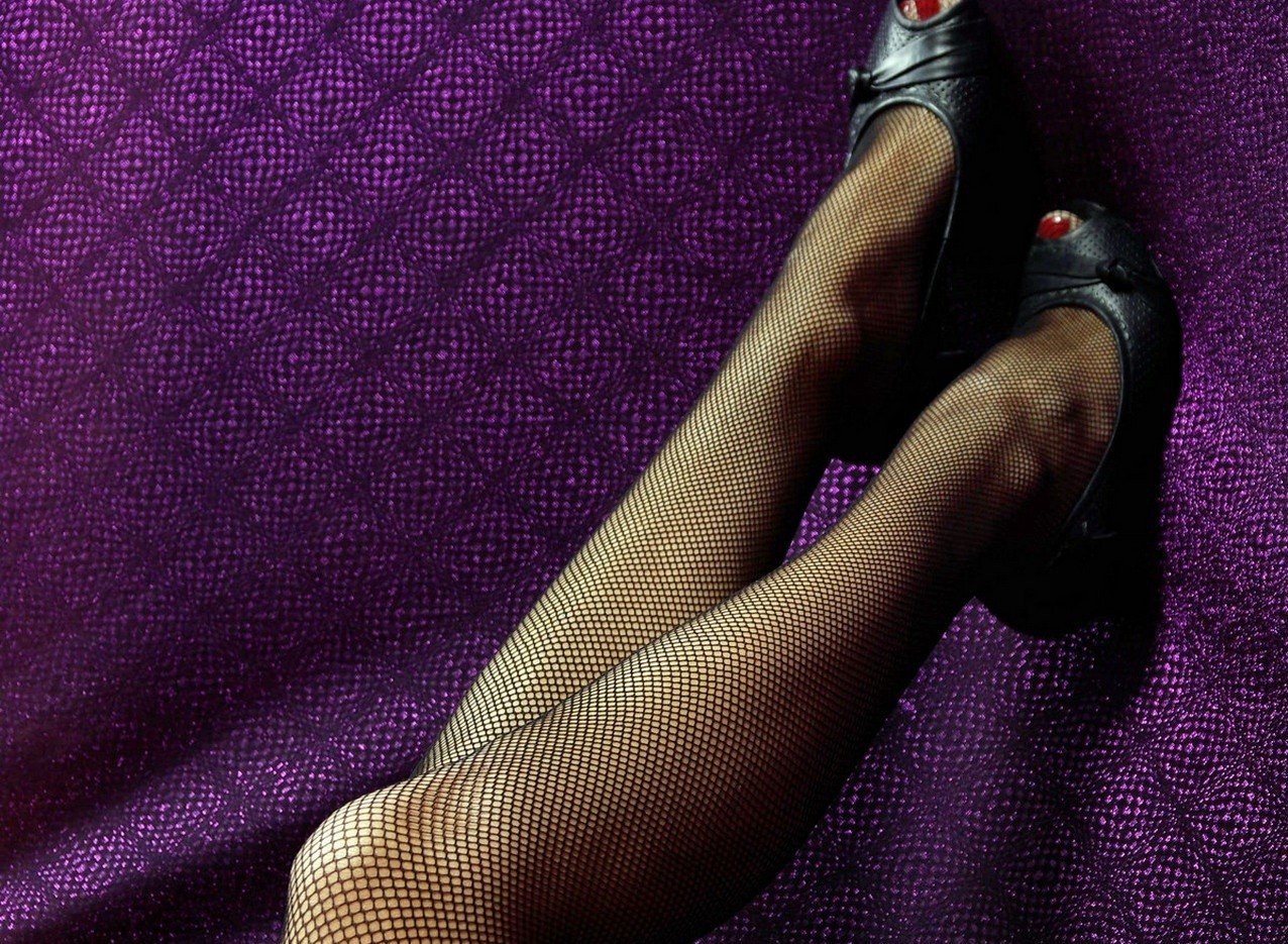 Legs donning fishnets tights