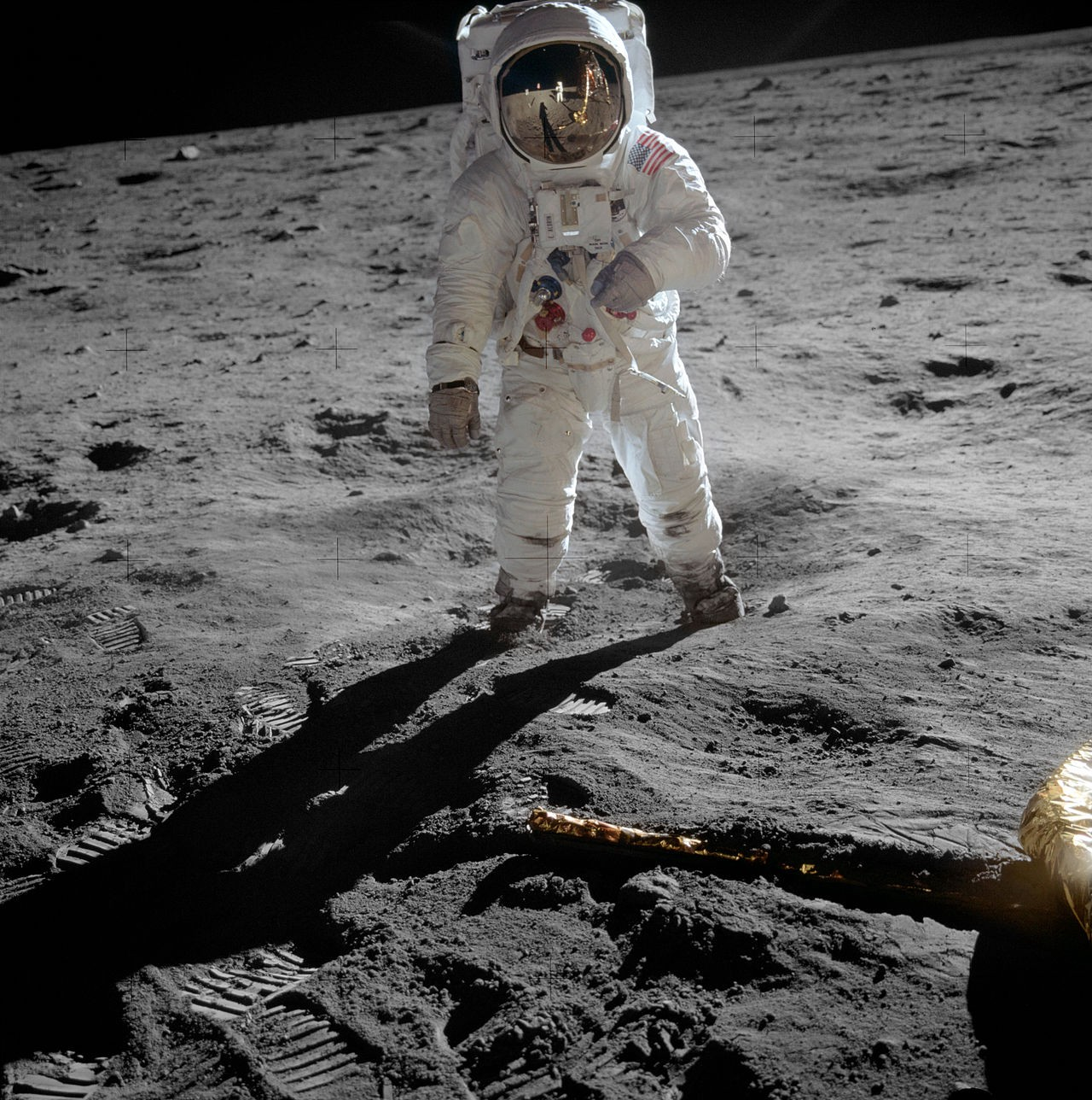 Photo of Buzz Aldrin on the moon taken by Neil Armstrong who is reflected in Aldrin's visor