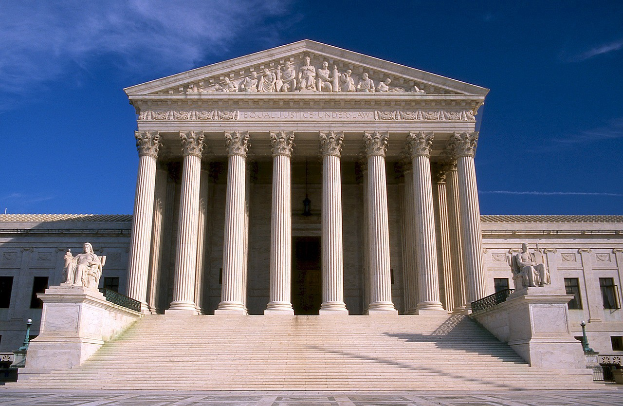 Front of Supreme Court building with stairs leading up to columns.